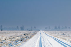 Snow covered countryside road stock photo