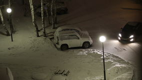 Snow-covered courtyard at evening. View from the stock video footage