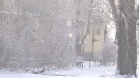 Snow covered courtyard. Piles for clothes in snowy yard stock video footage