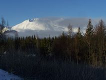 Snow-covered Cratered Chugach Mountain stock photo