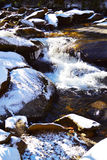 Snow covered Creek. Stream with rocks blanketed in snow Stock Photos