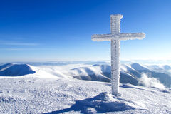 Snow-covered cross Stock Photography
