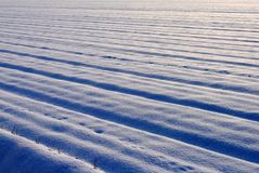 Snow covered cultivated field Stock Photo