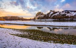 Snow Covered Devin Castle ar Sunrise. Snow Covered Devin Castle Ruins above the Danube River in Bratislava, Slovakia at Sunrise royalty free stock photography