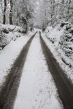 Snow covered dirt road in countryside. Kent England. Stock Photo