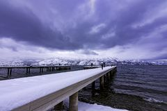 Snow covered dock on Okanagan Lake West Kelowna British Columbia Canada Royalty Free Stock Photos
