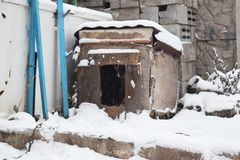 Snow-covered doghouse. Cold winter morning. Snow-covered yard.Winter. Snow-covered doghouse. Cold winter morning. Snow-covered yard stock image