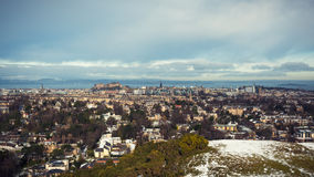 Snow covered Edinburgh panorama, including castle and firth of forth. Colorised image processing Royalty Free Stock Photo