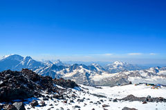Snow covered Elbrus mountains at winter sunny day Stock Image