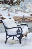 Snow covered empty bench Royalty Free Stock Photo
