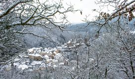 Snow covered Esch sur Sure town with lovely background of snow c. Snow covered Ardennes Luxembourg also known as Eislek and at the center is the Esch-sur-Sure Stock Image