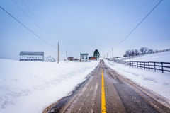 Snow covered farm along a country road in rural York County, Pen. Nsylvania Royalty Free Stock Image