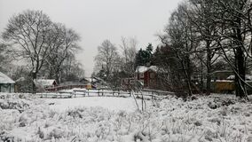 Snow covered farm house and paddock Stock Photos