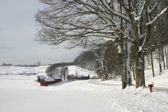 Snow covered farm nestled in the hills of Vermont Stock Images