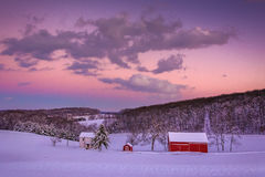 Snow covered farm and rolling hills at sunset, in rural York Cou Royalty Free Stock Images