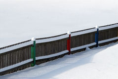 Snow covered fence. And field Stock Images