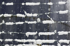 Snow covered fence background image. Snow on the grid. Royalty Free Stock Image