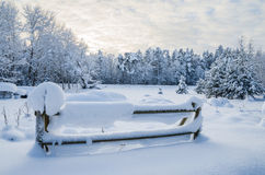 Snow-covered fence in the countryside.  Estonia Stock Image