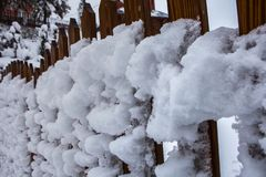 Snow-covered fence, snowstorm in the Carpathians, Ukraine Royalty Free Stock Image