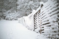 Snow Covered Fence in Winter - Snowy Landscape stock image