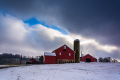 Snow covered field and a barn in rural York County, Pennsylvania Royalty Free Stock Image