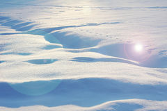 Snow covered field with light flares Royalty Free Stock Photo
