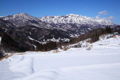 Snow covered field and Mt.Togakushi Royalty Free Stock Photos