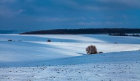 Snow-covered fields stock photography