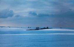 Snow-covered fields royalty free stock photography