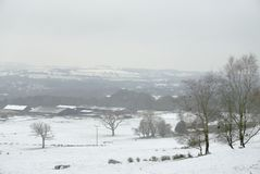 Snow covered fields in Lancashire. Winter scene of snow covered farmland and hill`s in Lancashire during a cold spell in December Royalty Free Stock Photo