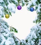 Snow covered fir branches with Christmas balls Royalty Free Stock Image