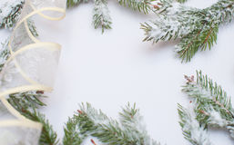 Snow-covered fir branches and Christmas decorations with space for text Stock Photo
