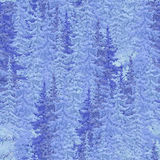 Snow-covered fir Christmas forest. seamless image Stock Photos