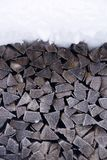 Snow covered Firewood Stock Image