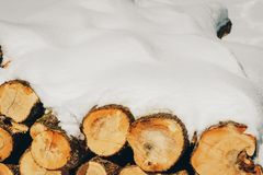Snow covered firewood stack Stock Photo