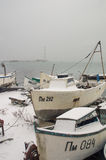Snow-covered fishing boats in Pomorie Royalty Free Stock Photo