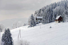Snow-covered flank of hill, winter mountains Stock Photo