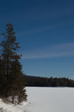 Snow covered frozen Northern Ontario lake background stock photography