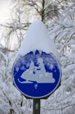 Snowmobile traffic sign covered with snow royalty free stock photos