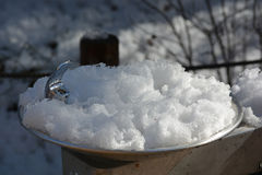 Snow Covered Frozen Water Fountain.  Stock Photo