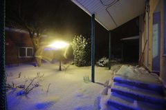 Snow covered garden in the backyard, winter night time. Stock Photo