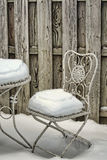 Snow Covered Garden Chair and Table Stock Photos