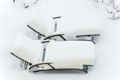 Snow-covered garden furniture Stock Images