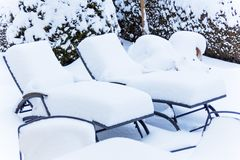 Snow-covered garden furniture Royalty Free Stock Photography