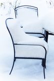 Snow-covered garden furniture Stock Photo