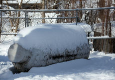 Snow Covered Gas Tank Stock Photo