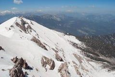 Snow-Covered Gebirgsspitze Stockfoto
