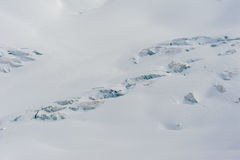 Snow covered glacier crevasses and seracs in snow field Stock Photo