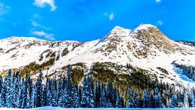 The snow covered granite rock face of Yak Peak in the Zopkios Ridge of the Cascade Mountain Range near the Coquihalla Summit. Seen from Highway 5, the royalty free stock photos