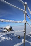 Snow covered handrail. On the top of the Mount Kasprowy durin temperature inversions, Tatra Mountains, Poland royalty free stock photography